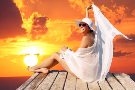 sunsets: Sexy Woman against sunset over sea