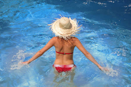 Woman in the swimming pool during summer season  photo