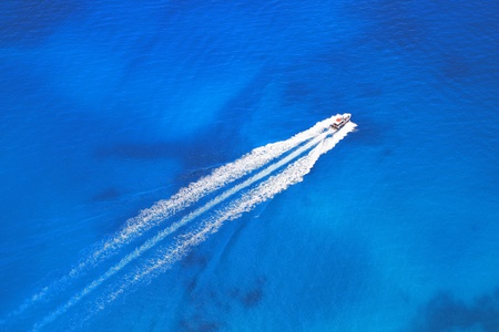 tranquil atmosphere: Speed boat on the azure sea