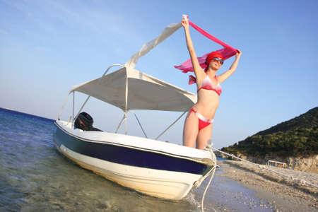 Sexy Woman in bikini on Motor Boat in summer time photo