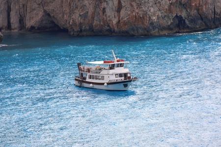 Coast of Greece with tourist boat, Lefkas Island photo