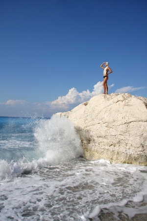 Summer paradise with sexy woman above azure sea photo