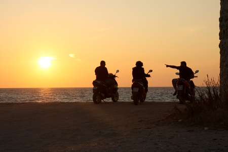 tearaway: Motorbikers against sunset over the sea