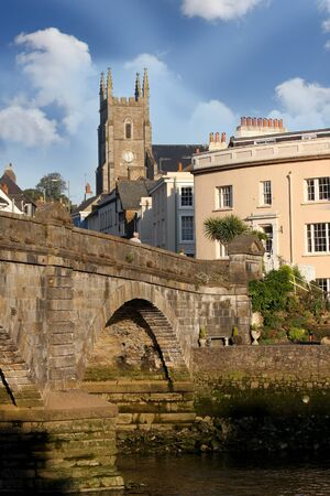devon: Totnes old church with bridge in Devon, England
