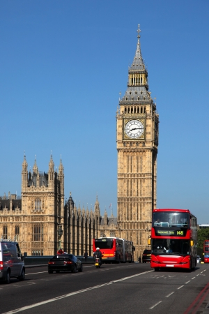 city of westminster: Big Ben with red double-decker in London, UK Stock Photo
