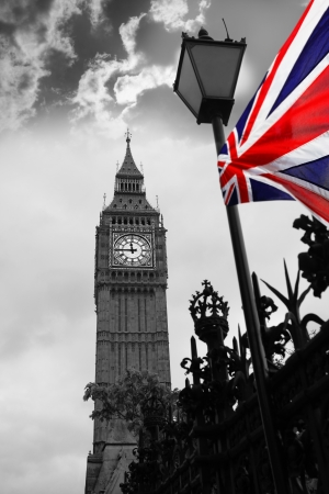 english famous: Big Ben with flag of England in London, UK