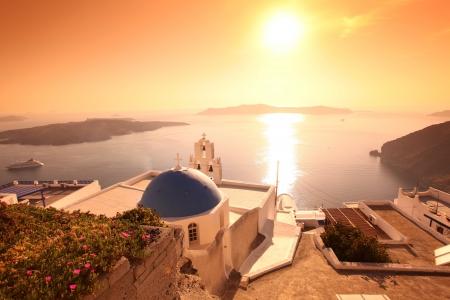 firostefani: Santorini with Firostefani Church against sunset over sea, Fira, Greece Stock Photo