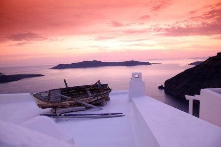 santorini: Santorini with  boat on white roof in Fira, Greece