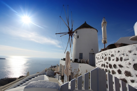 Santorini with famous windmill in Greece, Oia village photo