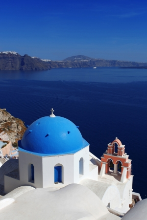 Santorini with famous  chuch in Greece photo