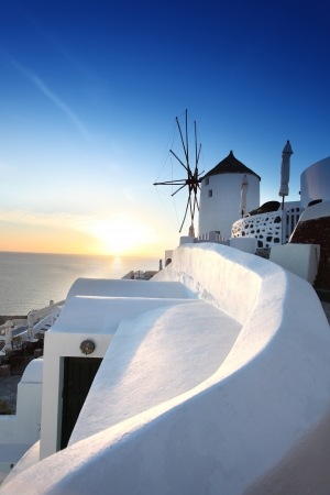 santorini: Santorini with windmill against sunset in  Greece