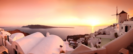 Famous Santorini Island with windmill in Greece photo
