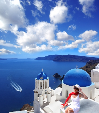 Santorini with sexy Woman against churches in Greece