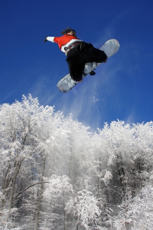 Snowboarder jumping against blue sky Stock Photo - 14846676