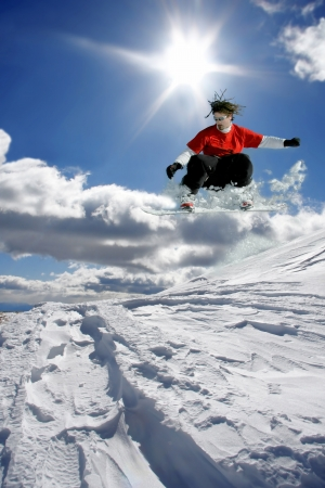 Snowboarder jumping against blue sky Stock Photo - 14835060