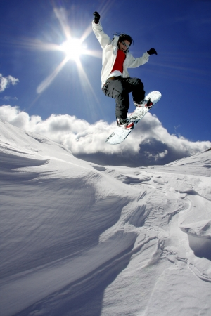 Snowboarder jumping against blue sky Stock Photo - 14846672