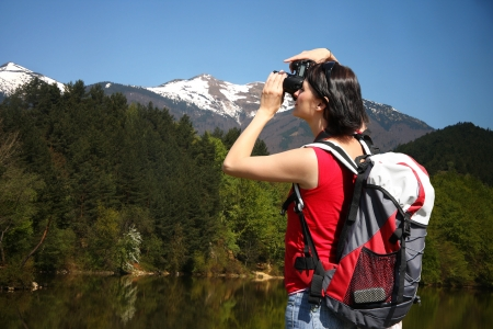 Young Woman photographer in mountains  photo