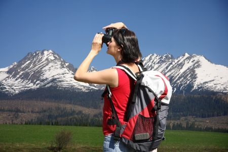 photographers: Young woman photographer in the mountain Stock Photo