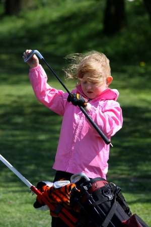 little girl playing golf photo