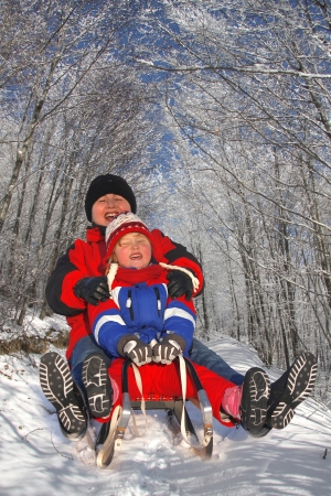 winter family sledging Stock Photo - 17402750