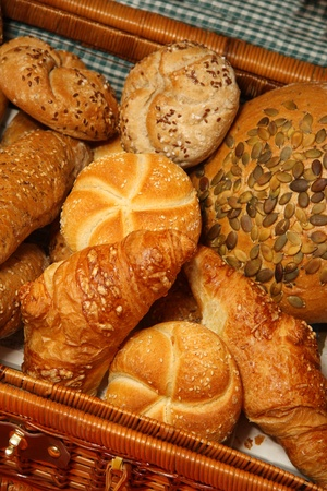 assortment of baked bread and rolls photo