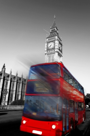 Big Ben with red city bus in London, England
