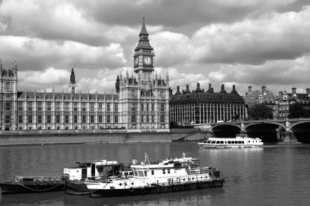 Big Ben with city boat in London, England photo