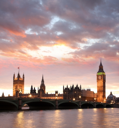 english bus: Famous Big Ben in the evening with bridge, London, England