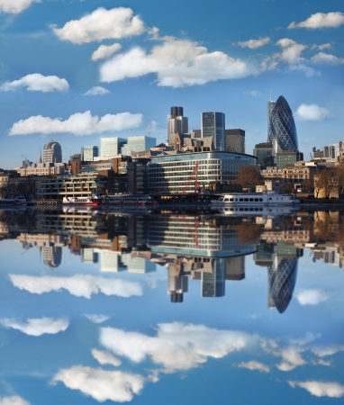 river bank: Modern London cityscape with boat, LONDON, UK