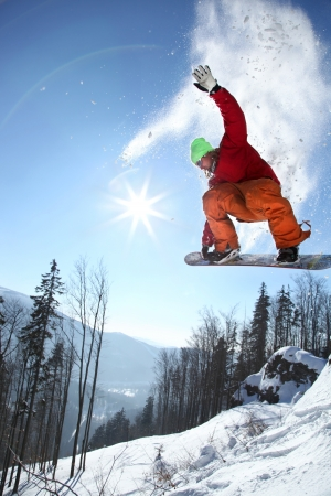 snowboard: Snowboarders jumping against blue sky