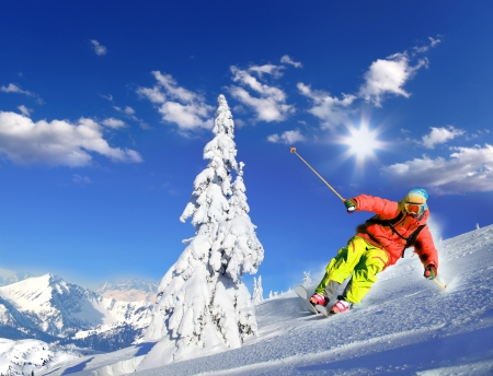 downhill skiing: Skier skiing downhill in high mountains