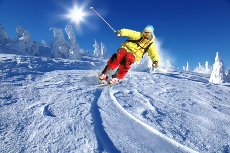 winter sports: Skier skiing downhill in high mountains
