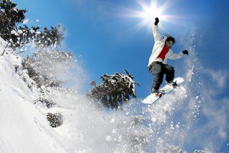 Snowboarder jumping against blue sky Stock Photo - 15383571