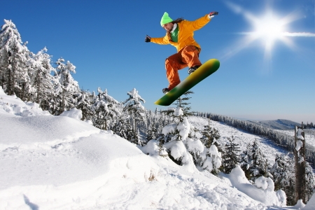 to ski: Snowboarder jumping against blue sky Stock Photo