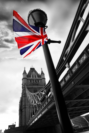 black history: Tower Bridge with flag of England, London