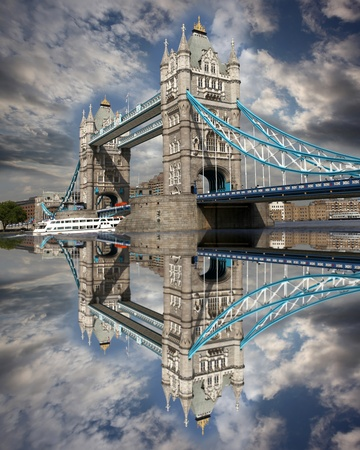 Tower Bridge with boat in London, England photo