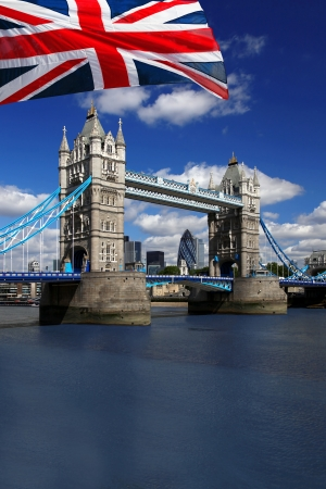 london tower bridge: Tower Bridge with flag of England in London Stock Photo