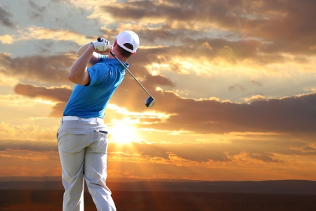 golf bag: Man playing golf