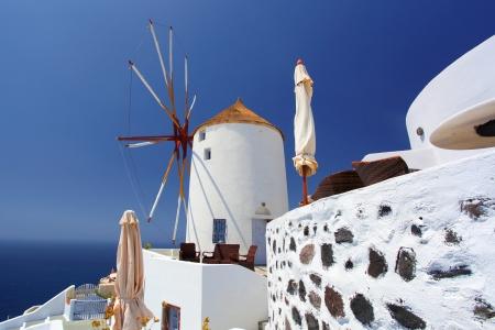 Santorini with famous windmill in Greece, Oia village photo