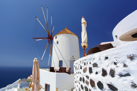 santorini caldera: Santorini with famous windmill in Greece, Oia village
