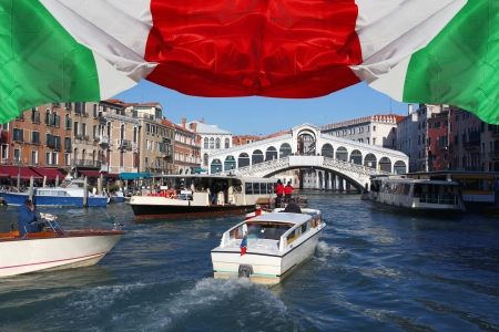 Venice with Rialto bridge and with boats on Grand Canal, Italy photo