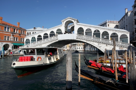 rialto bridge: Venice with Rialto bridge and with boats on Grand Canal, Italy Stock Photo