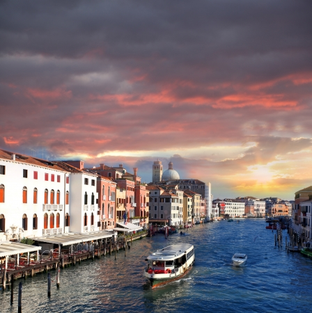 taxi famous building: Venice with boats on Grand canal in Italy