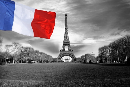 Eiffel Tower with flag of France in Paris city Stock Photo