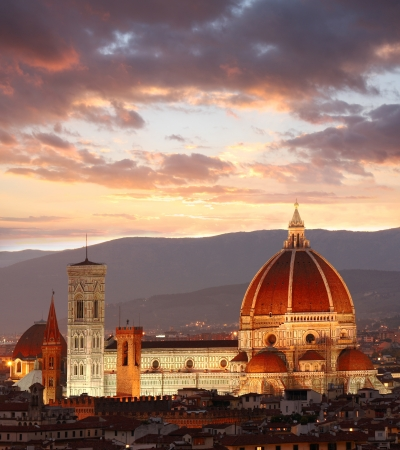 duomo: Florence Cathedral against colorful sunset in Italy