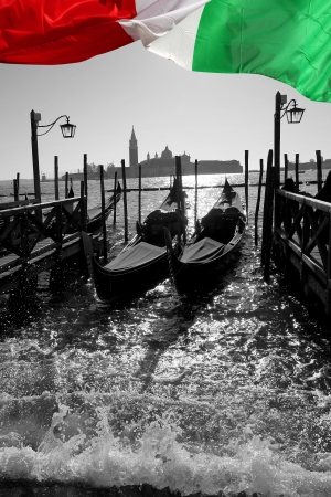 Venice with gondolas on Grand Canal against San Giorgio Maggiore church photo