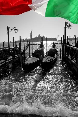 Venice with gondolas on Grand Canal against San Giorgio Maggiore church photo