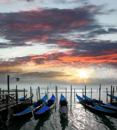 Gondolas against sunset in Venice, Italy photo