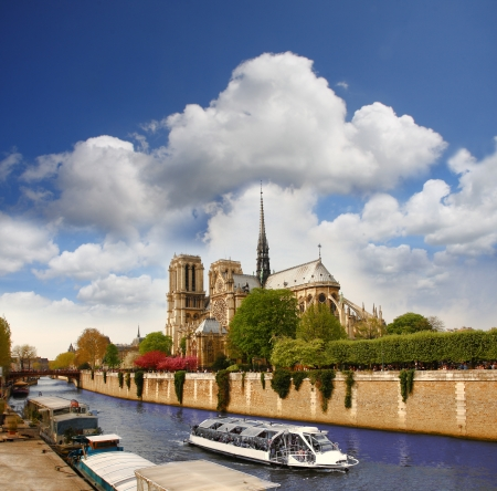 notre dame cathedral: Paris, Notre Dame with boat on Seine, France Stock Photo