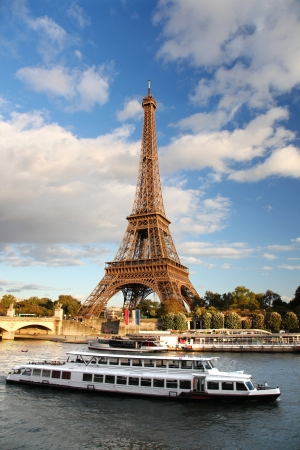 Seine in Paris with Eiffel tower against white boat, France